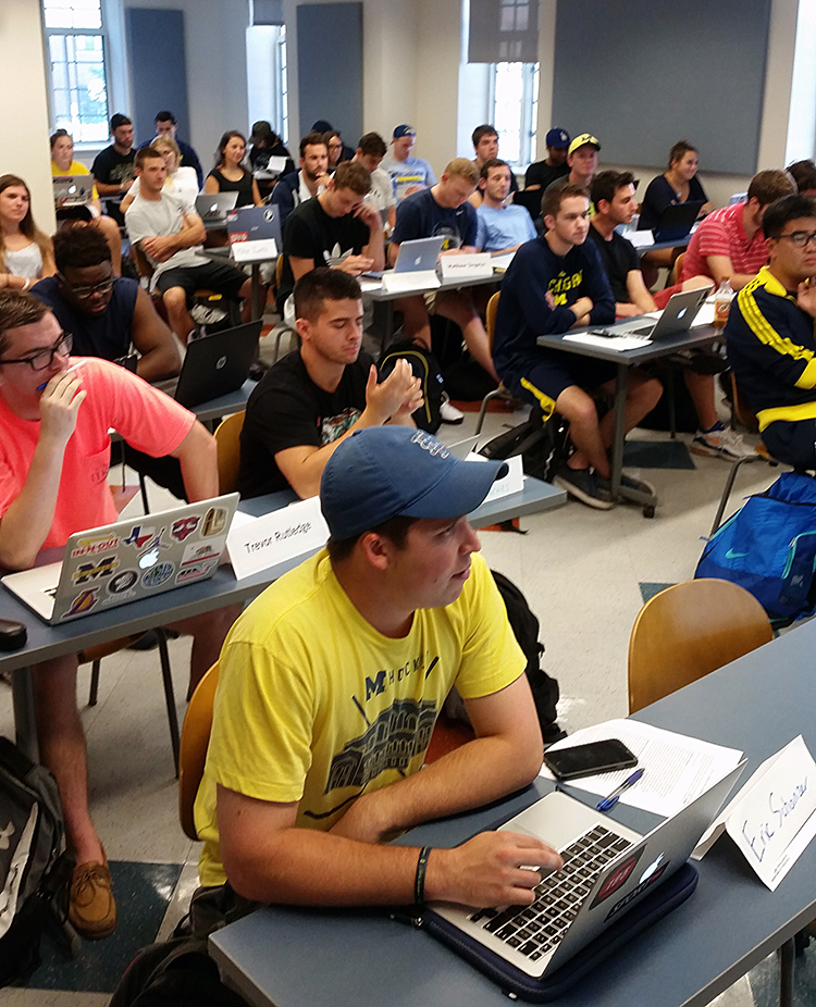 Sport Management students listen intently