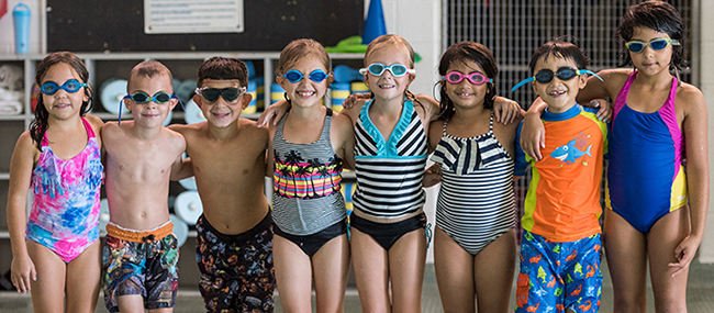 A diverse group of children attending a swim class