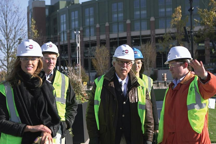Dr. Mark Rosentraub (center) at Titletown / Lambeau Field in Green Bay, WI