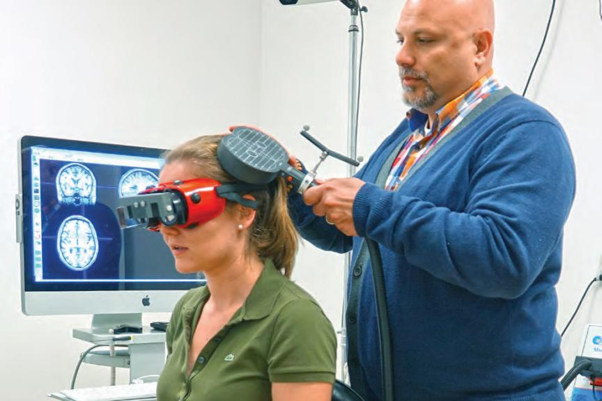Dr. Vesia (right) and student in the Brain Behavior Lab