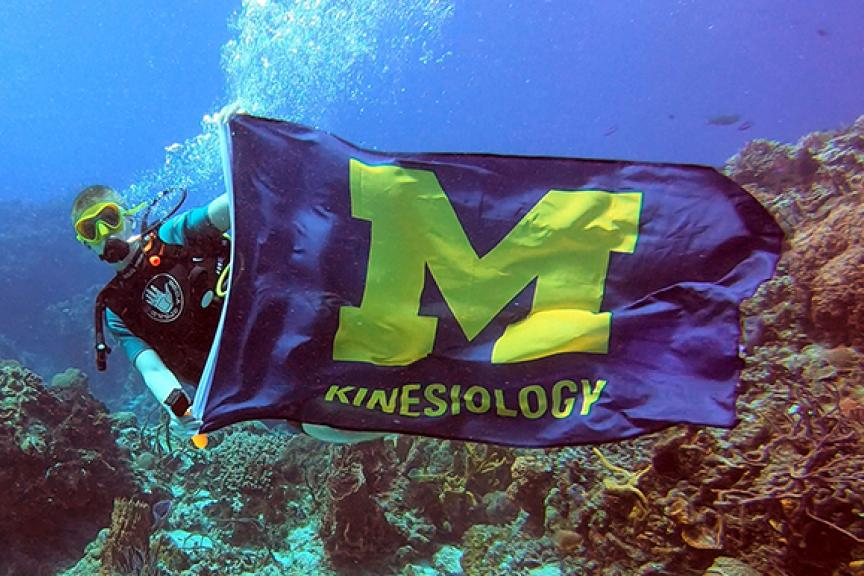 A student takes the Kines flag scuba diving