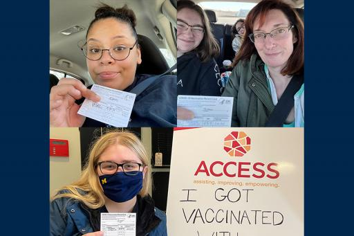 Students showing off their COVID vaccine cards