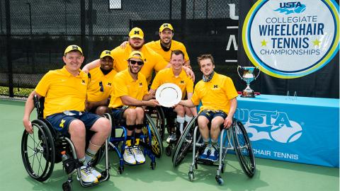 U-M Wheelchair Tennis team holding trophy